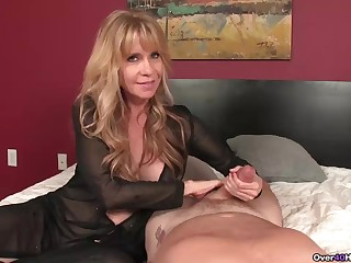 Oldr milf jerks off a  and makes him spurt his cum