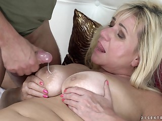 Mature busty blonde Pam Left-hand gets cum all over her jumbo tits