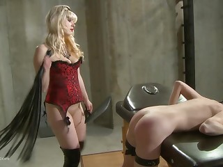 Light-complexioned lesbian mistress tortures her redhead slave with respect to wax and toys