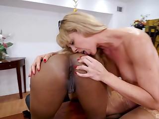 Blonde mature enjoys a bit of ebony pussy in lesbian XXX