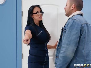 Nerdy MILF in glasses Reagan Foxx rides her buyer at the office