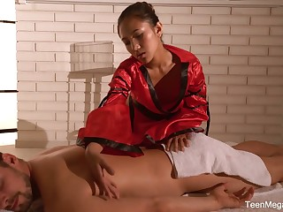 Raven haired Asian masseuse May Thai is poked upon sideways pose
