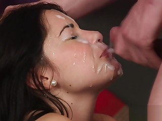 Frisky doll gets cumshot on her face swallowing throughout get under one's ejaculate