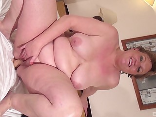 Beamy mature with big saggy tits pleasuring herself with a dildo