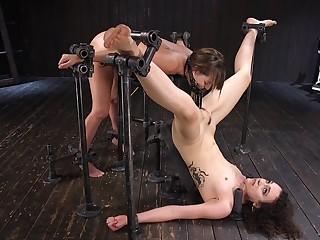 Brisk BDSM fucking machine amulet with two slave girls