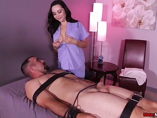 Massage qualified Crystal Rush frees her boobs while stroking a dick