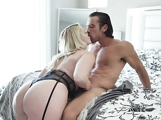 Muscular guy makes hallow with the man blonde mistress on bed